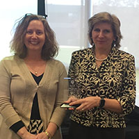 Elizabeth Wager (left) accepts her award from Kathy Johnson (right)